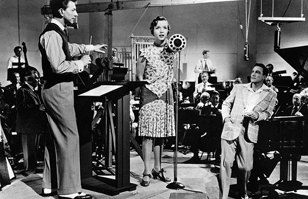 Debbie Reynolds sings in front of Gene Kelly and Donald O'Connor